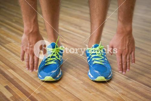 Low section of man in sports shoes in fitness studio