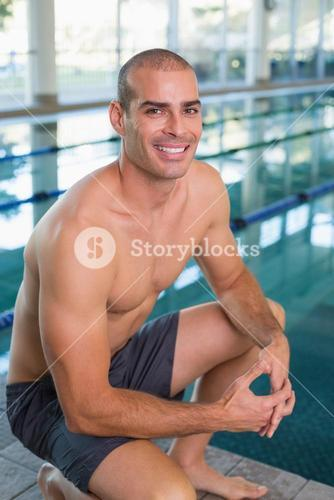 Fit swimmer by pool at leisure center