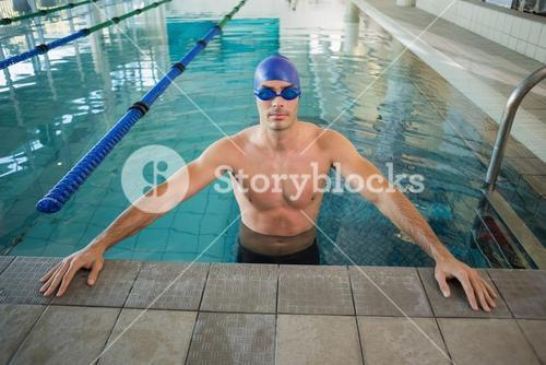 Fit swimmer in pool at leisure center