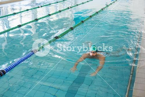 Man swimming in pool at leisure center