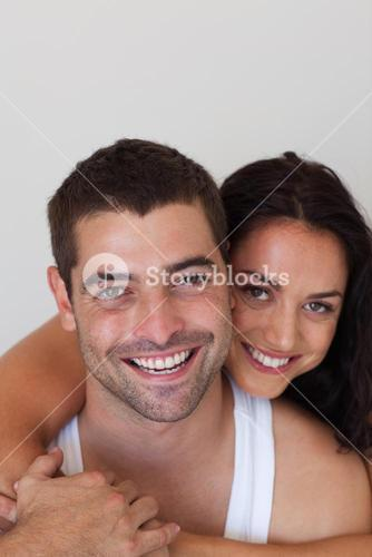 Enamoured couple smiling at camera