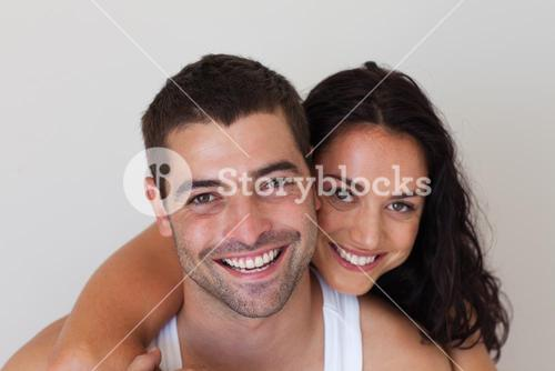 Delighted woman hugging her boyfriend