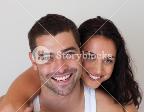 Portrait of a blissful couple against white background