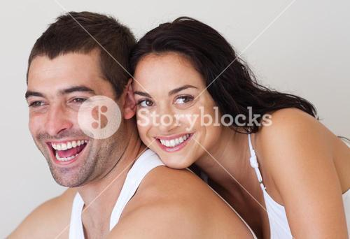 Affectionate couple sitting in a bed