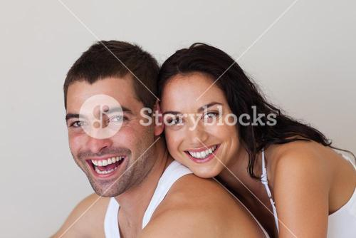 Young couple smiling at camera