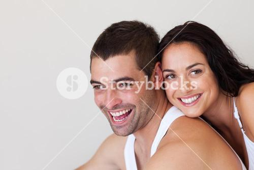 Smiling couple sitting on the bed