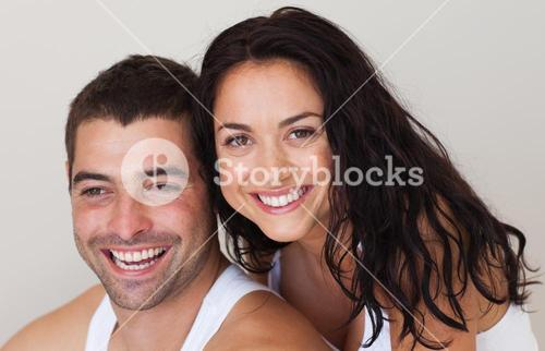 Young smiling romantic couple relaxing