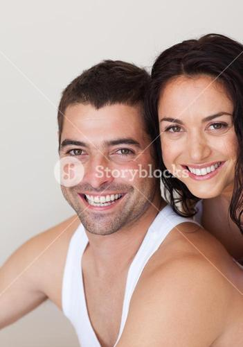 Handsome couple smiling at camera