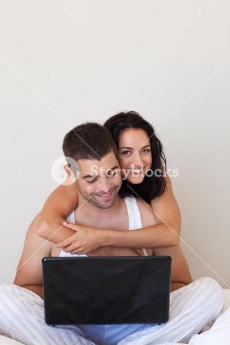 Enamoured couple with laptop
