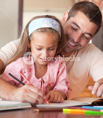 Father and cute daughter drawing together