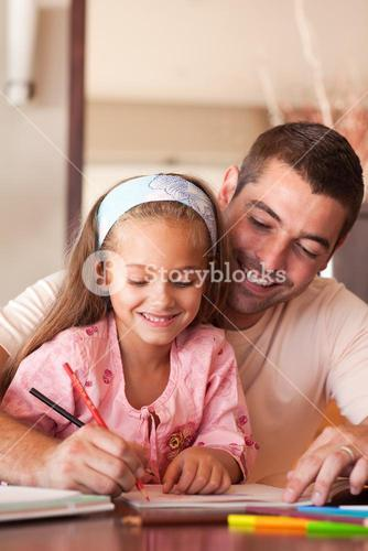 Delighted family drawing with colourful pen