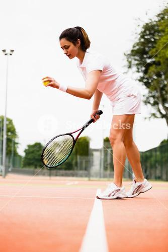 Tennis player playing a match on the court