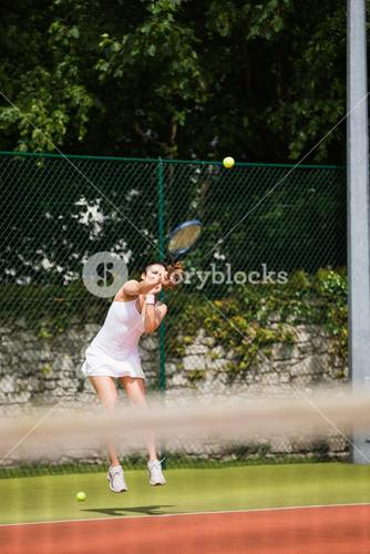 Pretty tennis player serving the ball