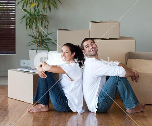 Glowing couple relaxing after buying a house
