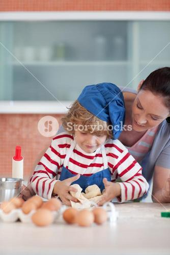 Young sweet child baking