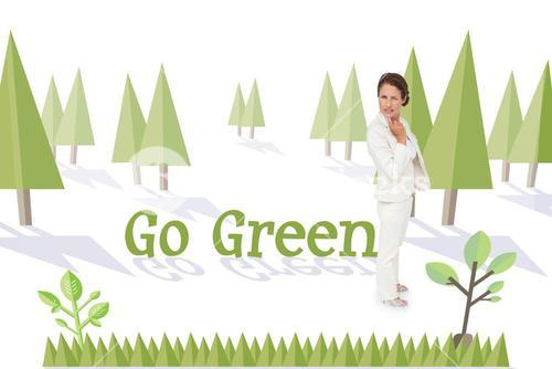 Go green against forest with earth tree