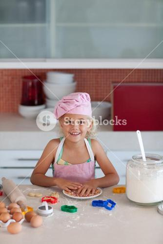Little blond girl smiling at camera