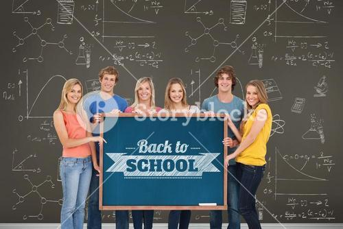 Group of people holding blackboard with message on wooden board