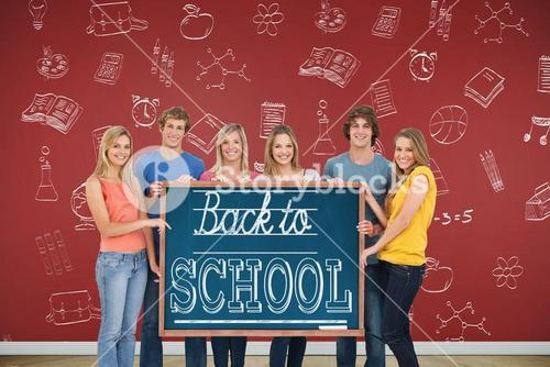 A group of people holding blackboard with message on wooden board
