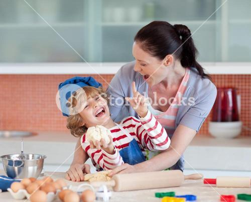 Laughing family having fun in the kitchen