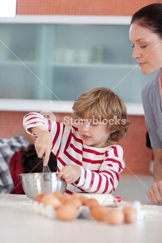 Little boy working in the kitchen