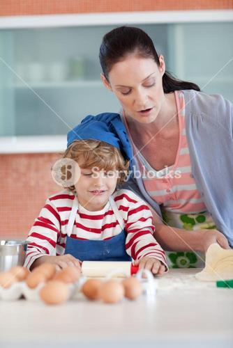 Brunette woman baking with a little boy