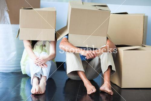 People under cartons