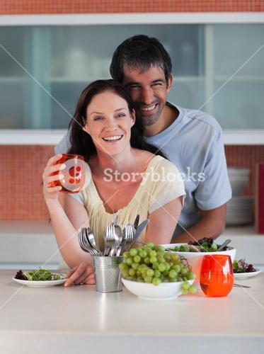 Intimate couple standing in the kitchen