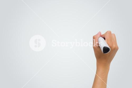 Female hand writing with marker