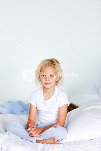 Adorable girl on a bed