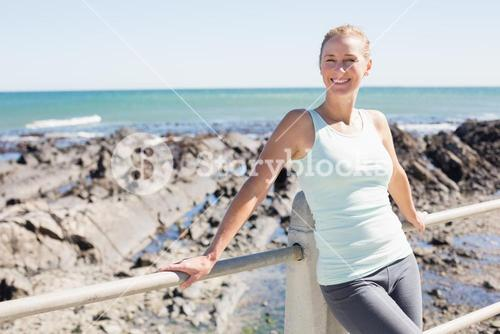 Fit mature woman standing on the pier