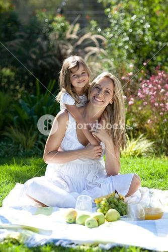 Handsome young mother with her daugther