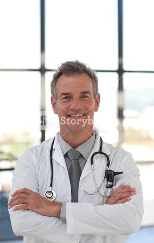 Charismatic doctor smiling at the camera