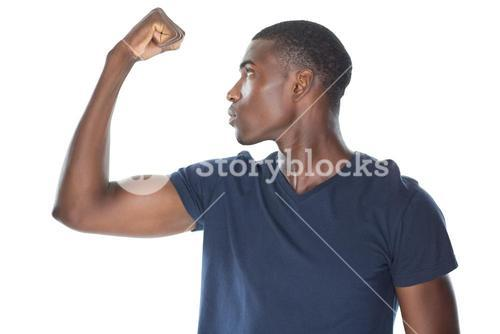 Close up of a casual young man flexing muscles