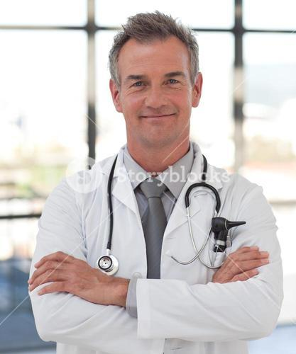 Elderly doctor with folded arms smiling at the camera
