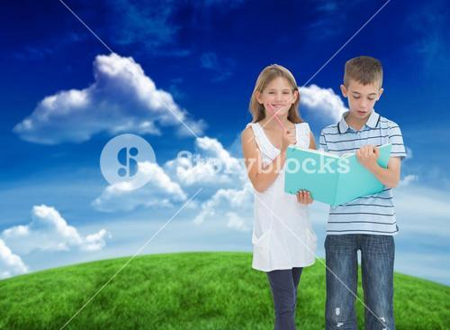 Composite image of brother and sister learning their lesson together