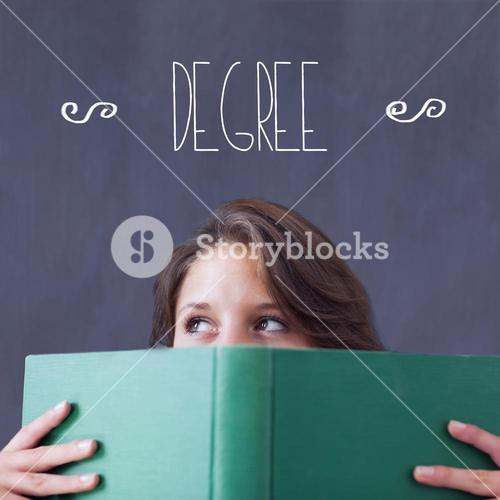 Degree against student holding book