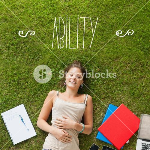 Ability against pretty student lying on grass