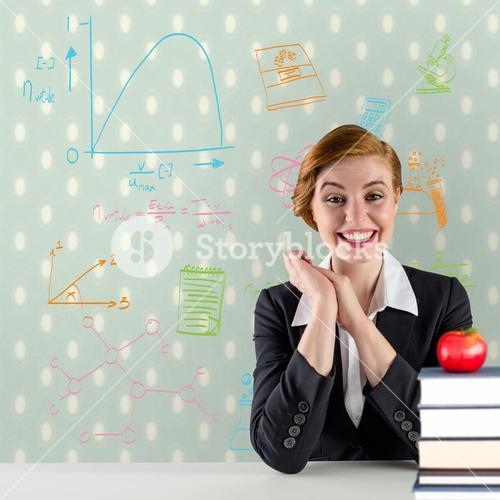Composite image of excited redhead teacher sitting at desk