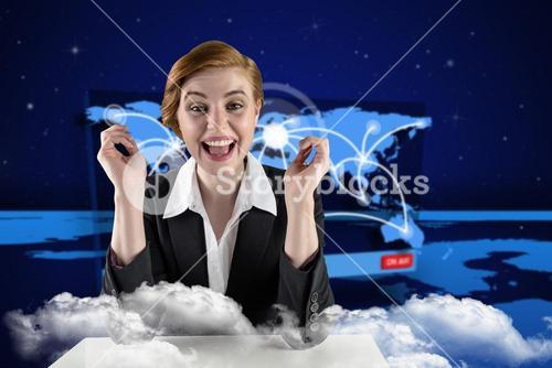 Composite image of excited redhead businesswoman sitting at desk