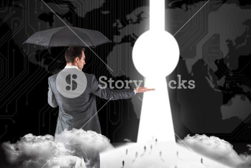 Composite image of businessman holding an umbrella with hand out