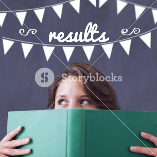 Results against student holding book