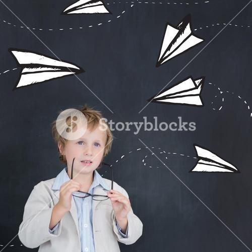 Composite image of cute pupil holding glasses