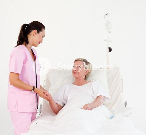 Beatiful nurse with a elderly woman