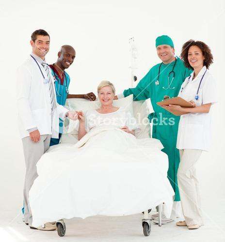 Group of doctors attending to a patient