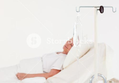 Elderly woman in a hospital bed