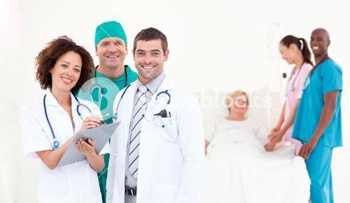 Team of doctors and nurses working on a hospital ward