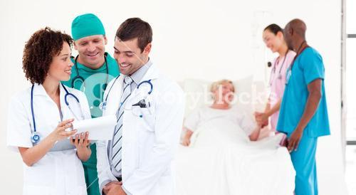 Group of international doctors with a patient