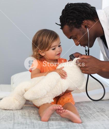 Doctor with a cute child in a hospital