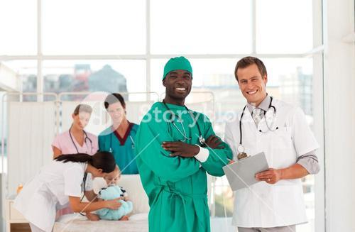 Surgeon and doctor with medical team